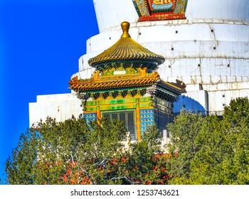 Buddhist White Stupa Dagoba Colorful Memorial Beihai Park Jade Flower Island Beijing China Beihai created in 1000 AD. Stupa built in 1600s for 5th Dalai Lama