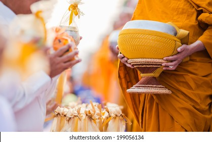 buddhists have faith in buddhism. giving alms to monks