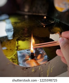 Buddhists make merit points incense candles Buddha image.