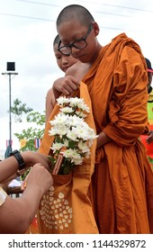 "Buddhists offer flowers to monks during  the ""  Tak bat dok mai "" festival as part of buddhist lent day at temple in Bangkok on July 28, 2018."