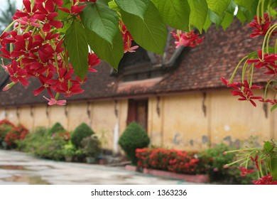 Buddist monastry Framed with red flowers