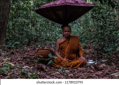 Buddist monk made meditation in deep forest religion concept