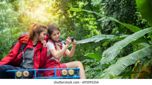 Buddy Friends Traveler are Hiking and Traveling on 4x4 Off-Road Roof in the Forest for Camping in Holiday Summer - Travel and Recreation Concept