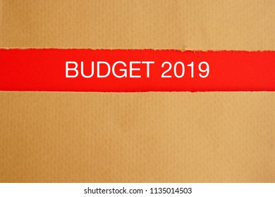 Budget 2019 on below torn brown paper - financial concept