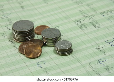 budget sheet with coin stack