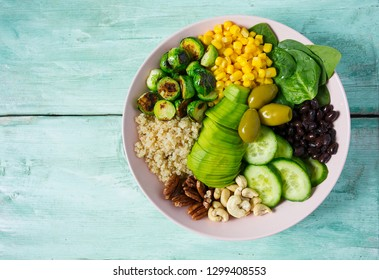 budha bowl with brussel cabbage, corn, quinoa, cucumbers,nuts, avocado and spinach