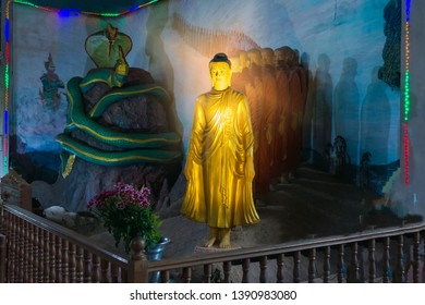 budha and disciple stutue with Two serpents tied together on the big mountain