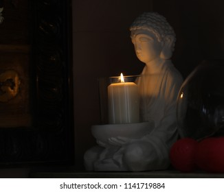 budha meditation statue with candle