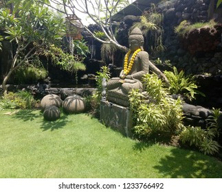 Budha statue on the green grass in the garden