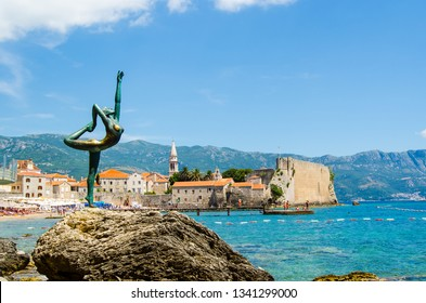 Budva Montenegro 06/08/2016 The old town of Budva and the sculpture of a woman - a symbol of Budva in Montenegro