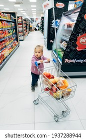 Budva, Montenegro - 17 march 2021: A child with a small cart in a supermarket.