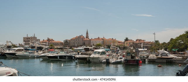 Budva, Montenegro- August 19, 2016: Old Town of Budva and marina with yachts and boats