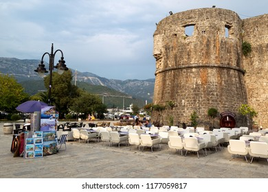 BUDVA, MONTENEGRO - August 2, 2018: A street cafe underneath the walls of the fortress of the Old Town of Budva