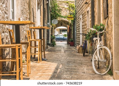 Budva, Montenegro - August 28, 2017: Old Town Street Budva, Montenegro. The first mention of this city - more than 26 centuries ago. We see ancient houses, a very narrow street, cafes, shops.