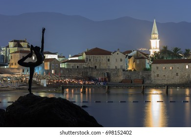 BUDVA, MONTENEGRO - AUGUST 9, 2014: Monument to the ballerina as a symbol of the city of Budva, Montenegro against the background of the fortress at night