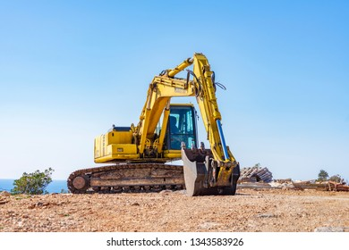 Budva, Montenegro, February 25, 2019: Construction site on a sunny spring day on the shore of the Adriatic Sea. In the foreground is an excavator that digs the ground, see in the background