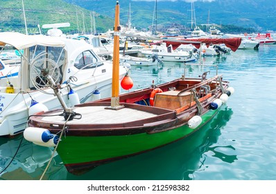 BUDVA, MONTENEGRO - JULY 12, 2014: The tiny tourist boat is the best choice for the leisure trip or fishing next to the coastline of Budva riviera, on July 12 in Budva