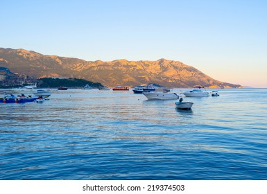 BUDVA, MONTENEGRO - JULY 12, 2014: The coastline of the Budva riviera in the last minutes of sunset, on July 12 in Budva.