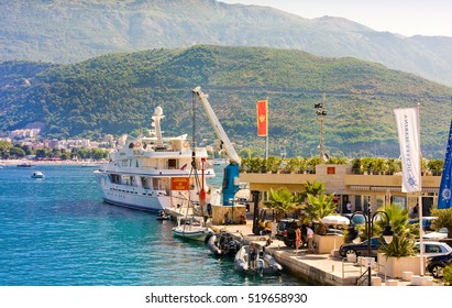 BUDVA, MONTENEGRO - JULY 12, 2015: Slovenska Obala is the city promenade, leading to the citadel in the old town with many tourist boats and luxury yachts in the small shipyard