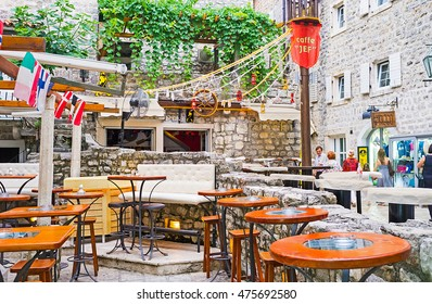 BUDVA, MONTENEGRO - JULY 15, 2014: The street bar in old town, decorated with the mast, ropes and flags, looks like the yacht's deck, on July 15 in Budva.