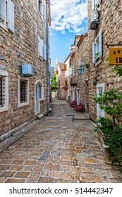 BUDVA, MONTENEGRO - JULY 18, 2014: Picturesque narrow street in Budva. Budva among the oldest urban settlements of the Adriatic coast, a UNESCO World Heritage Site.
