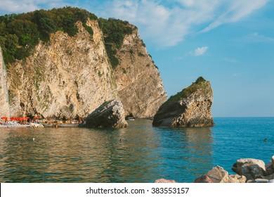 BUDVA, MONTENEGRO, JULY 21 - 2013: Tourist enjoying the hot summer on Island of Sveti Nikola - Budva Riviera, Budva, Montenegro, July 21, 2013