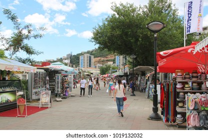 BUDVA, MONTENEGRO - JULY 30, 2017: Slovenska Obala, main beachside promenade with souvenir shops, market stalls, beach bars and fast -food outlets. Budva is a major tourist destination in Montenegro