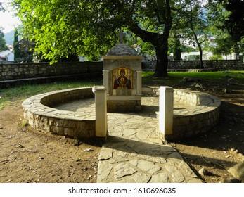Budva, Montenegro - June 20, 2019. Spring well with ikon of Paraskeva The Serbian in the park of Paraskeva's church.