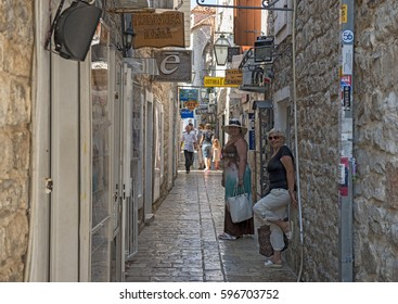 BUDVA, MONTENEGRO - JUNE 28: Tourists are walking through streets of old town on June 28, 2013 in Budva,Montenegro.