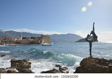 BUDVA, MONTENEGRO - MARCH 30: Dancing girl and Budva old town on background on October 30, 2017.