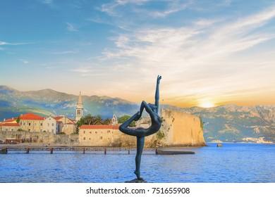BUDVA, MONTENEGRO - MAY 11: Beautiful view of the sculpture Ballerina Dancer of Budva at sunset. MAY 11, 2016 in Budva