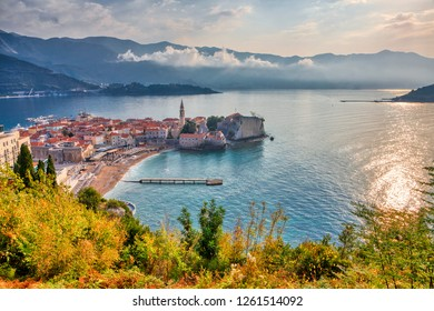 BUDVA, MONTENEGRO - OCTOBER 20, 2018: The old town of Budva, the Obala (l) and Kupacica beaches are seen on October 20, 2018 in Budva, Montenegro.