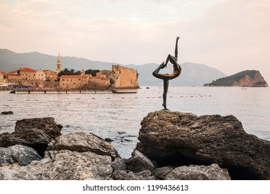 Budva / Montenegro - September 27, 2018:  Dancing Girl Statue - an attractive sculpture and popular photo opportunity for tourists on background of old city Budva.. Most popular photo with Mont