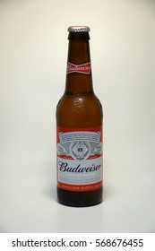 Budweiser beer bottle.  American style pale lager alcoholic beverage produced by brewer Anheuser Busch in United States - Illustrative Editorial.