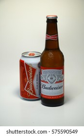 Budweiser beer can and bottle.  American style pale lager alcoholic beverage produced by brewer Anheuser Busch in United States - Illustrative Editorial.