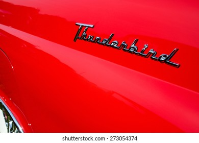 """BUENA PARK, CA - APRIL 19, 2015: Close up of a 1955 Ford Thunderbird chrome quarter panel emblem. Ford created a new market segment with the two seat Thunderbird, called """"the personal luxury car""""."""