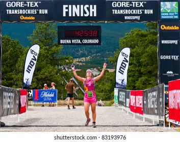 BUENA VISTA, CO - AUG. 21: Luciana Cox of Brazil finishes the 20.2 mile stage 1 race of the Run3 Gore-Tex TransRockies ultra-marathon in Buena Vista, CO on Aug 21, 2011.