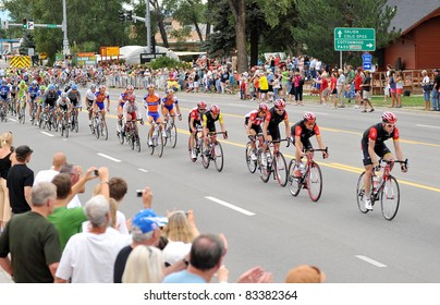BUENA VISTA, CO - AUG. 24: Levi Leipheimer (yellow jersey) and a pack of cyclists take the lead in the stage-3 portion of the Peloton during the US Pro Cycling Challenge on Aug. 24, 2011 in Buena Vista, Colorado. The bikers summit two peaks over 12,000 fe