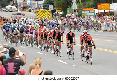 BUENA VISTA, CO - AUG. 24: Levi Leipheimer (yellow jersey) jockeys for position in a pack of cyclists in the stage-2 portion of the Peloton during the US Pro Cycling Challenge on Aug. 24, 2011 in Buena Vista, Colorado. The bikers summit two peaks over 12,