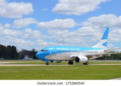 BUENOS AIRES (ARG). December 31, 2016: a Boeing 737-700 from Aerolineas Argentinas holding position, just after landing, in Buenos Aires' Aeroparque Jorge Newbery. Front spot of the aircraft.