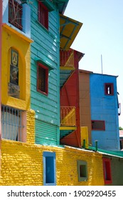 Buenos Aires, Argentina 01072012: La Boca area. Corrugated facades are painted in different colors, and window and door frames are in opposite colors under a silvery sky.