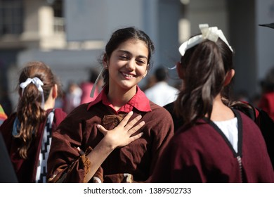 Buenos Aires, Argentina, 05-04-2019. Girls talking at a folklore festival in front of the Cabildo in Buenos Aires.