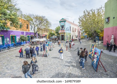 BUENOS AIRES, ARGENTINA - APR 10: People walking near the colorful houses of Caminito street in La Boca on Apr 10, 2013 in Buenos Aires, Argentina.