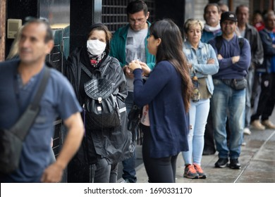 Buenos Aires, Argentina - April 02, 2020: Unidentified people doing long lines to get food and get into banks in a city under quarantine in La Matanza In Buenos Aires, Argentina