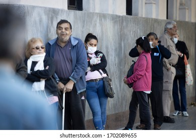 Buenos Aires, Argentina - April 04, 2020: Unidentified people doing long lines to get to the banks in a city under Quarantine in the city of Buenos Aires, Argentina