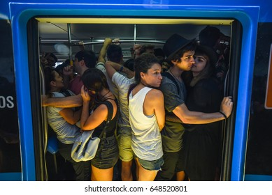 Buenos Aires, Argentina - April 1, 2017: Passengers standing in a train carriage during a rush hour at the Belgrano C station.