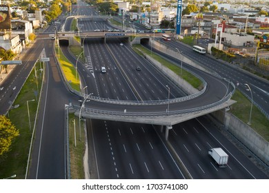 Buenos Aires, Argentina - April 11, 2020: Cars passing on a city under quarantine on easter saturday in Buenos Aires, Argentina