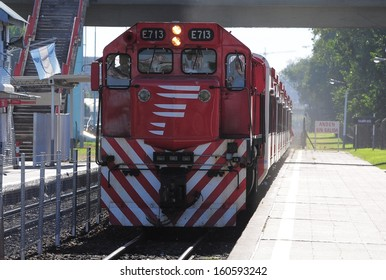 BUENOS AIRES, ARGENTINA - APRIL 14: Passenger train arrives to R. S. Ortiz station on April 14, 2013 in Buenos Aires, Argentina.