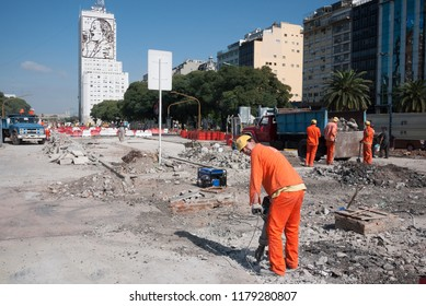 Buenos Aires, Argentina - April 16 2013: Men working in the construction of a new avenue and a metrobus system in Buenos Aires city