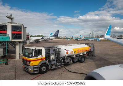 Buenos Aires, Argentina - April 3 2019:  Commercial airplane of Aerolineas Argentinas recharging fuel for a domestic flight in the local airport